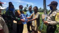 Pendistribusian fasilitas Prokes kepada masyarakat Desa Pajar Bulan